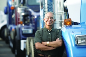 truck-driver-standing-next-to-semi